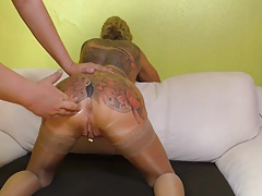 Ass fisting a pierced and tattoed mature slave slut