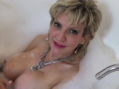Unfaithful english mature gill ellis displays her big boobie