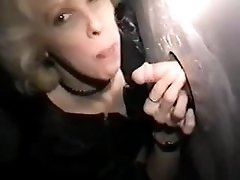 Mature slut enjoys a wide selection of cock at the gloryhole
