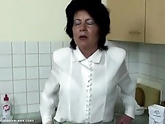 Granny gets pissing and fisting from girl