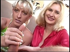 2 mature hotties giving handjob outdoors