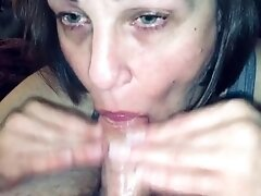 Mature Hotwife sucking our friends cock while I watch and comment. I love watching her suck cock