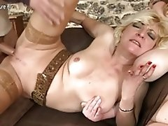 Two guys fucking three mature moms in group sex