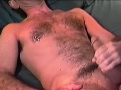 Mature dude Rick wanks his hard dick while moaning in joy
