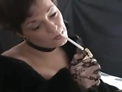 short haired smoking brunette mature in fur coat