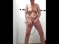 Milf using toy in shower and cums then Deepthroat a and cleans her cum off